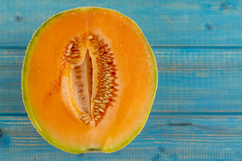 A cantaloupe in half which looks like a vagina